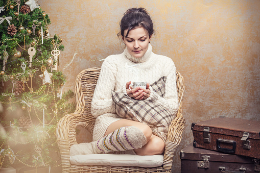 Beautiful Woman Drinking Tea Or Coffee Sitting In A Chair Stock Photo - Download Image Now