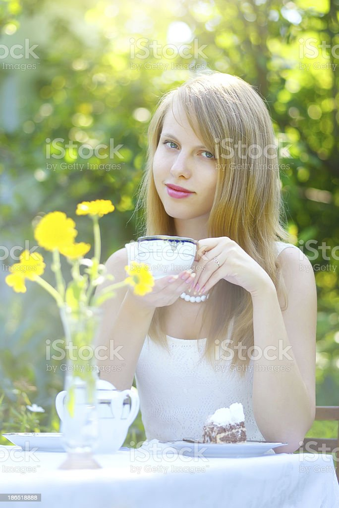 Beautiful woman drinking tea royalty-free stock photo
