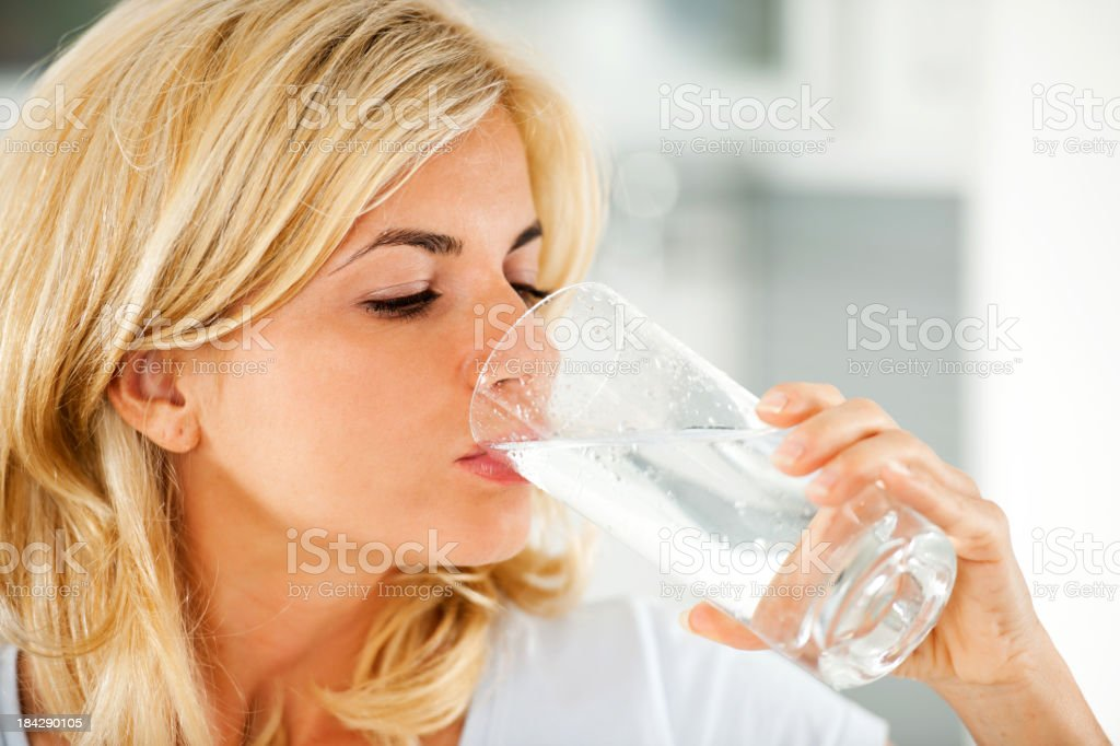 Beautiful woman drinking water royalty-free stock photo