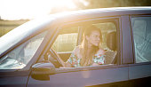 istock Beautiful woman driving a car 962230194