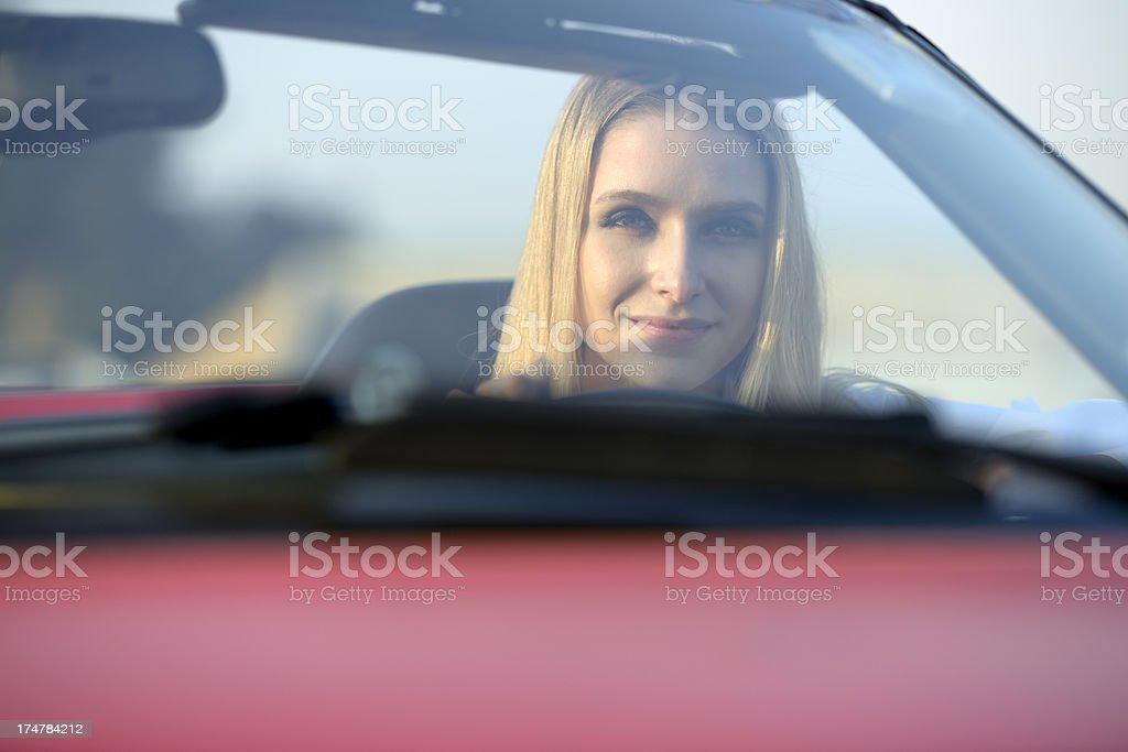 Beautiful woman driving a convertible stock photo