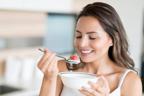 Beautiful woman eating a healthy snack stock photo