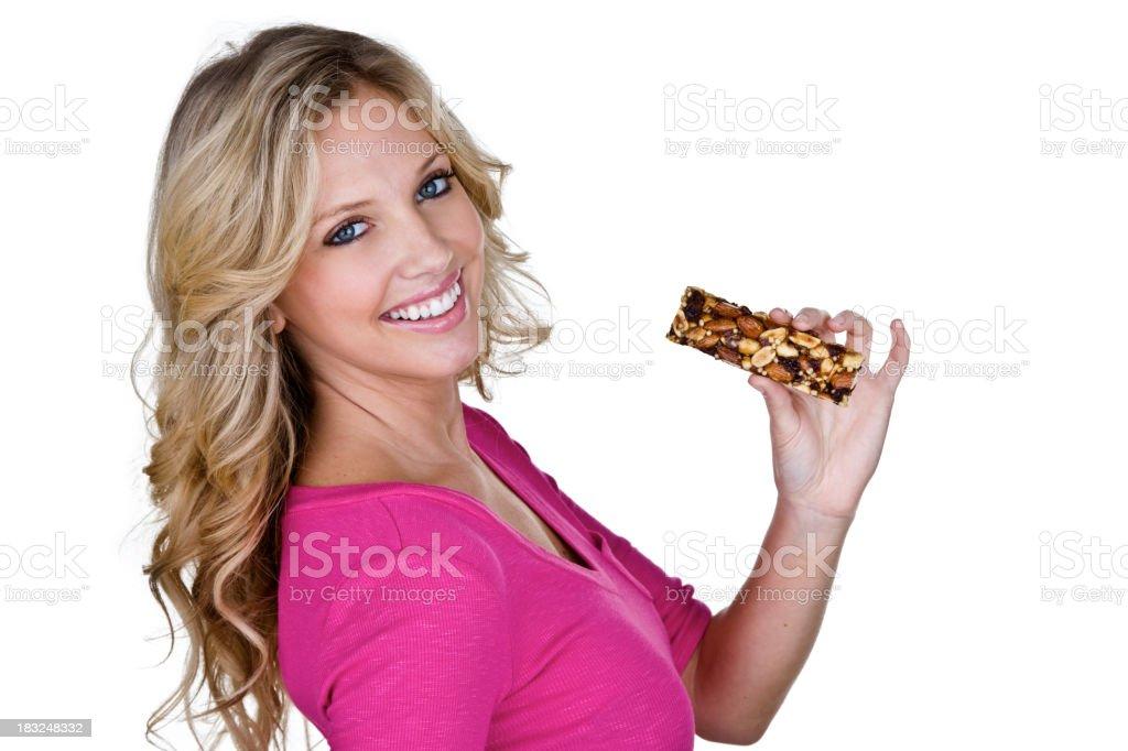 Beautiful woman eating a nut health bar royalty-free stock photo