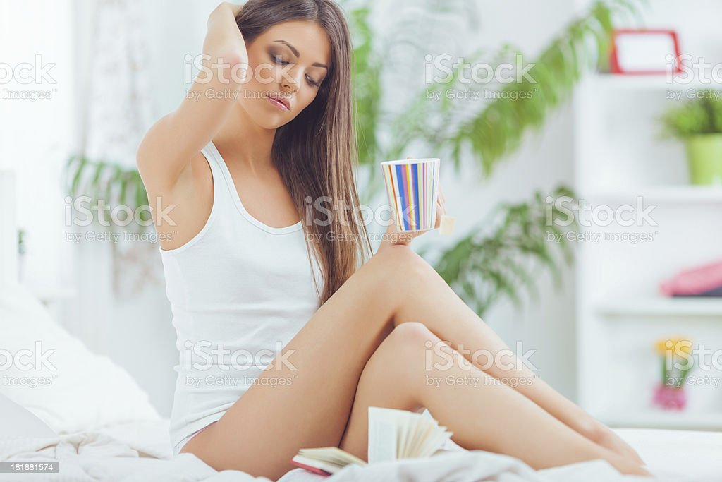 Beautiful woman eating and reading royalty-free stock photo