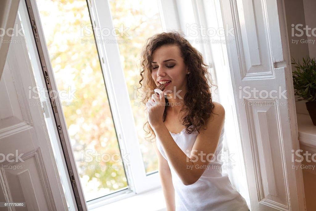 Beautiful woman eating cookie stock photo