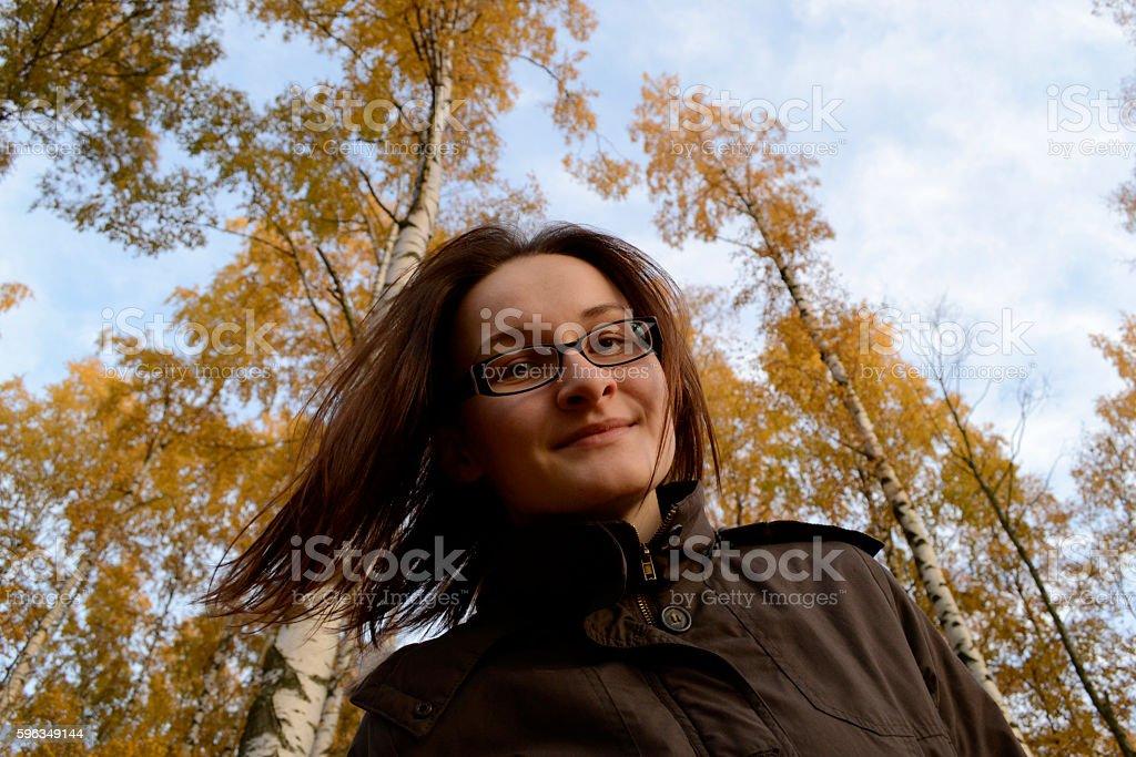 Beautiful woman enjoy autumn streaming her hairs. Woman is walki royalty-free stock photo