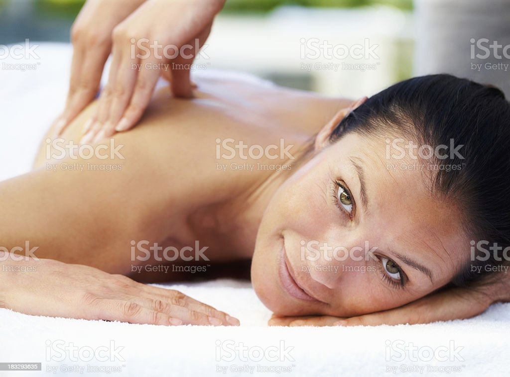 Beautiful woman enjoying a back massage royalty-free stock photo