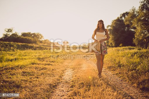 516318379 istock photo Beautiful woman enjoying a lovely sunny day in the nature 874225356