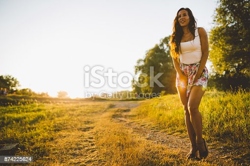 516318379 istock photo Beautiful woman enjoying a lovely sunny day in the nature 874225624