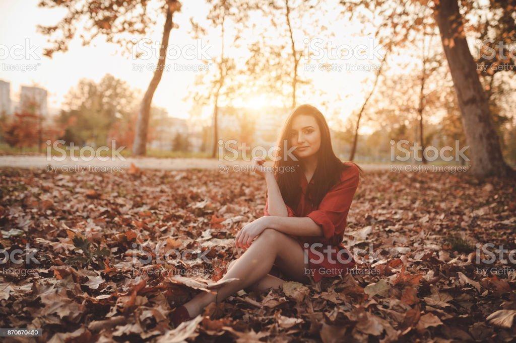 Beautiful woman enjoying autumn day stock photo