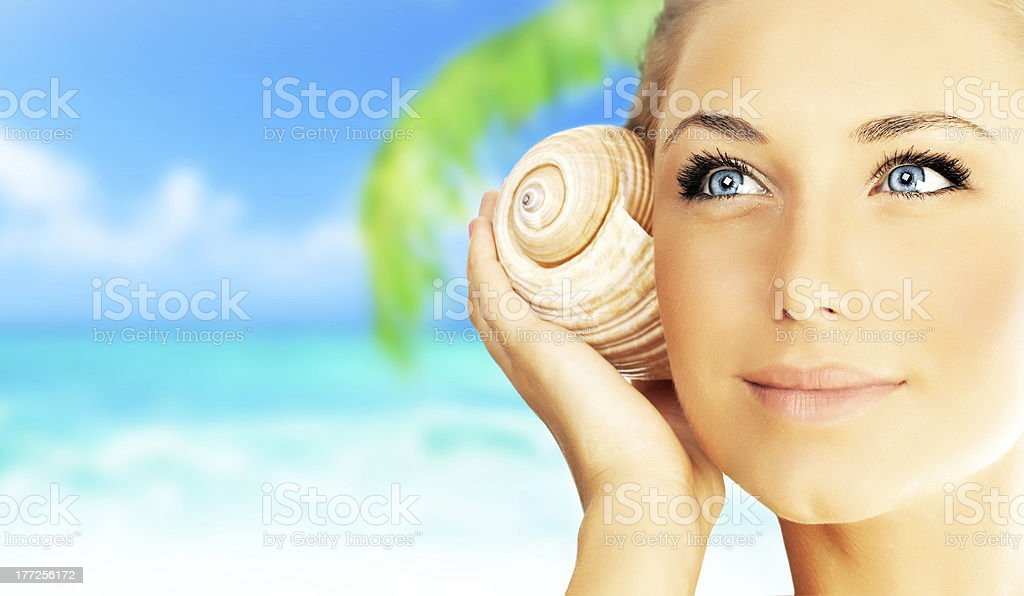 Beautiful woman enjoying beach royalty-free stock photo