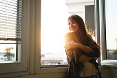 istock Beautiful woman enjoying fresh air 1297058755