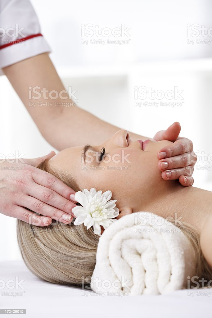 Beautiful woman enjoying head massage at spa royalty-free stock photo