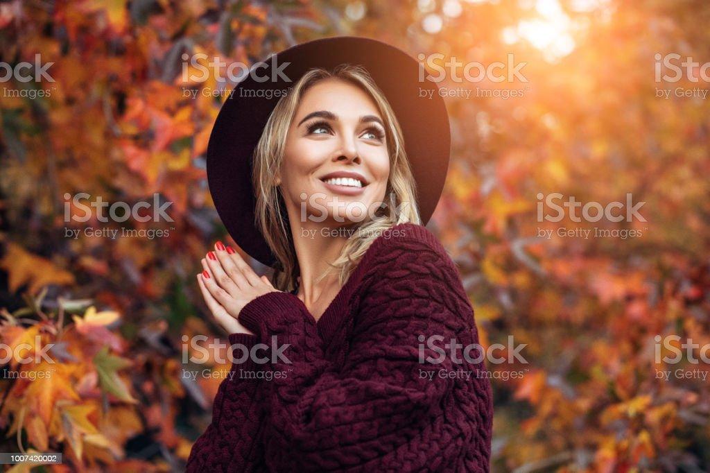 Beautiful woman enjoying in a sunny autumn day stock photo