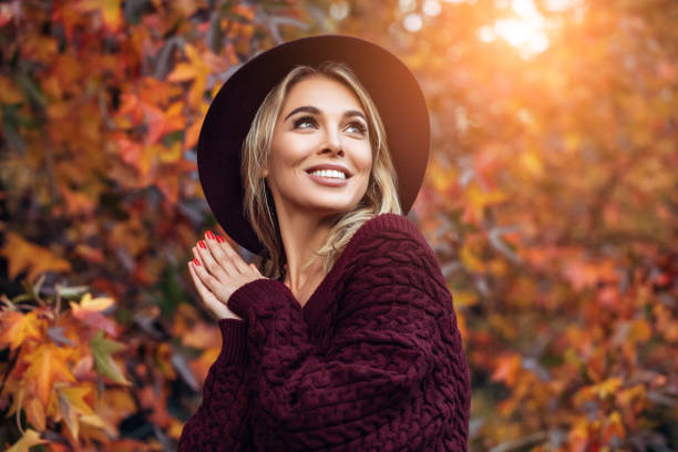 beautiful woman enjoying in a sunny autumn day - fashion стоковые фото и изображения
