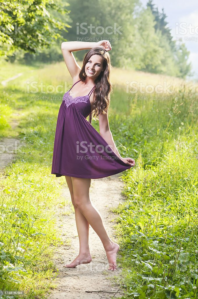 Beautiful woman enjoying in the nature and fresh air royalty-free stock photo