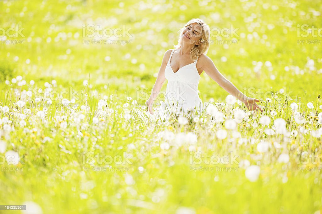 Beautiful woman enjoying in the nature and fresh air stock photo