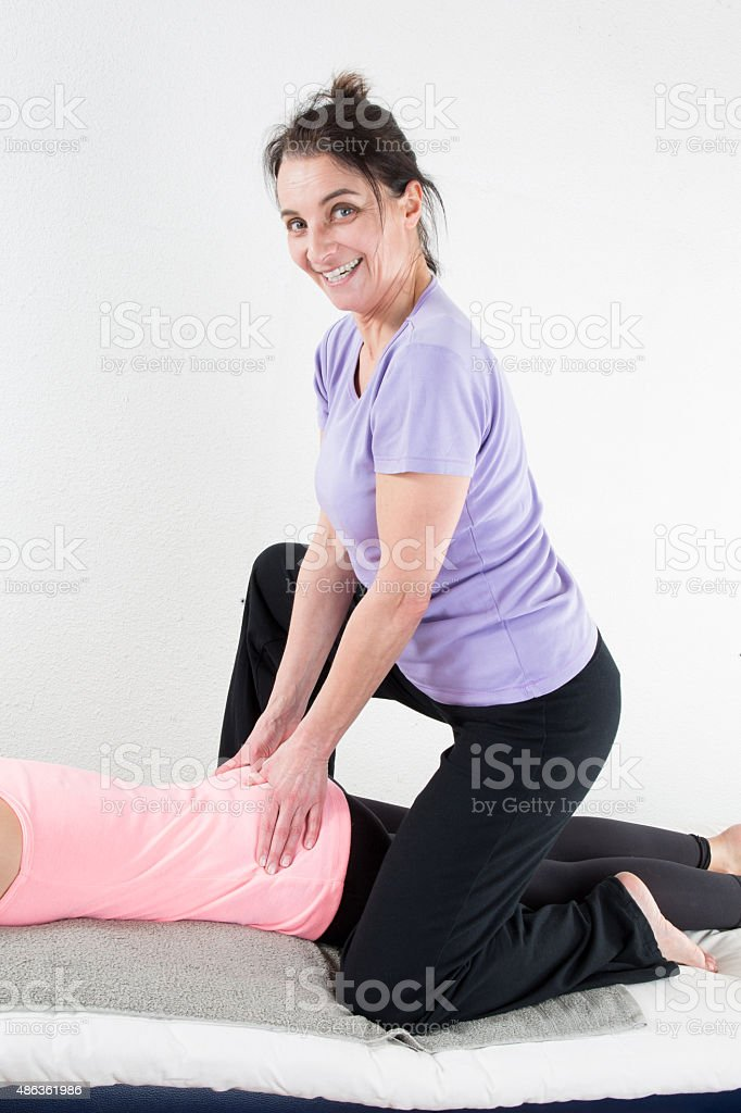 Beautiful woman enjoying massage stock photo