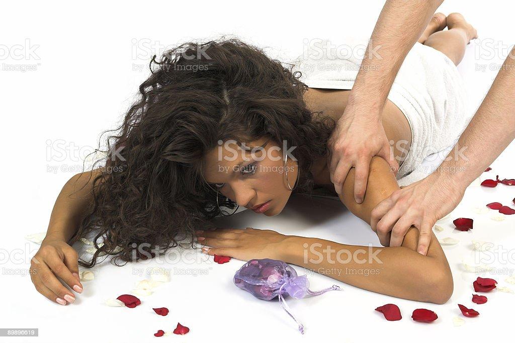 Beautiful woman enjoying massage royalty-free stock photo