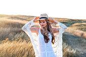 istock Beautiful woman enjoying nature outdoors at sunset. 1252287294