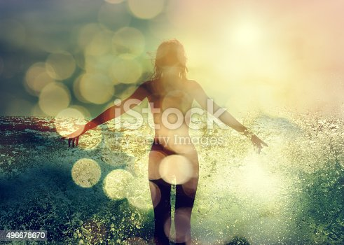 istock Beautiful Woman Enjoying Sea Waves. Rear View 496678670