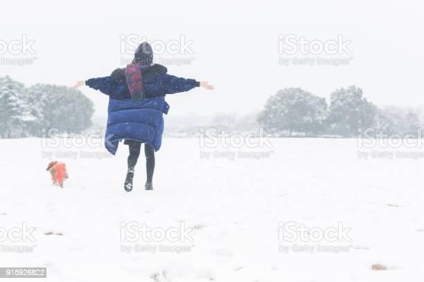 Beautiful woman enjoying snowfall with pet dog on snow picture id915926822?b=1&k=6&m=915926822&s=612x612&h=7regef2rvbzij0b ptkqubgxrsfsbsb9wleemt2gl88=