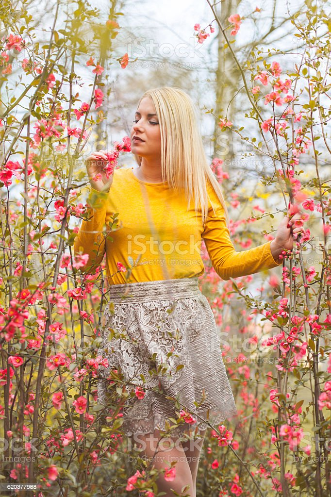Beautiful woman enjoying spring outdoors. zbiór zdjęć royalty-free