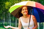 istock Beautiful woman enjoying summer rain 178978573
