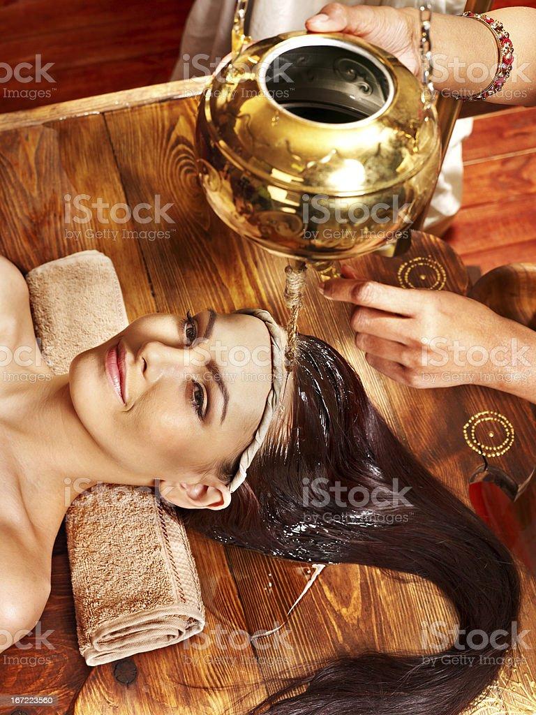 A beautiful woman enjoying the Ayurvedic spa treatment royalty-free stock photo