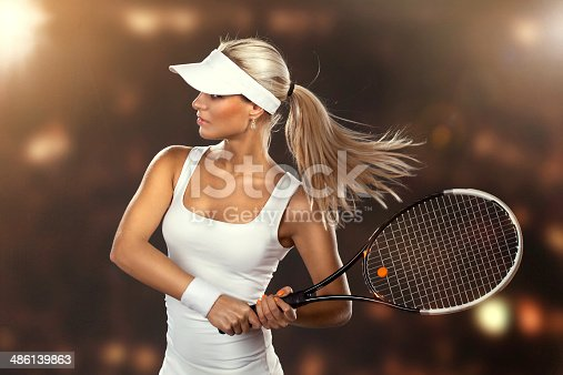 istock Beautiful woman enjoying the great game of tennis 486139863