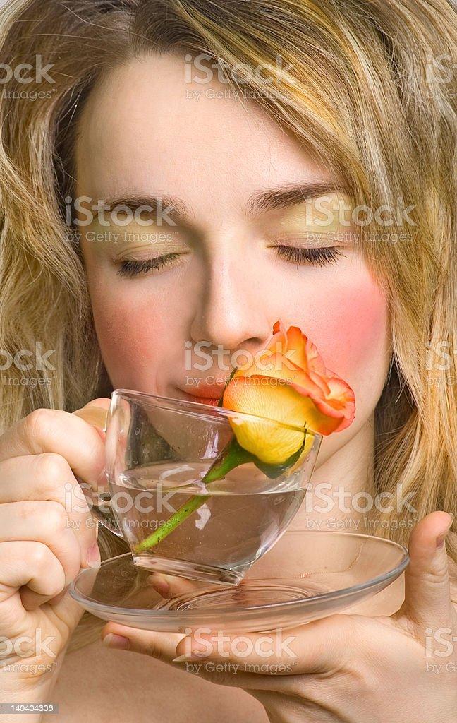 Beautiful woman enjoying the rose and water royalty-free stock photo