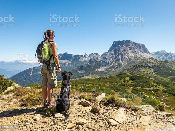 Beautiful woman enjoying the view with dog in the mountain picture id623279180?b=1&k=6&m=623279180&s=612x612&h=ok 0igk4vcujlcw53yjaemq1zpk905cmk6aobjgxg50=