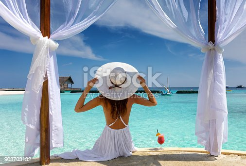 istock Beautiful woman enjoys her summer holiday in the tropics 903703132