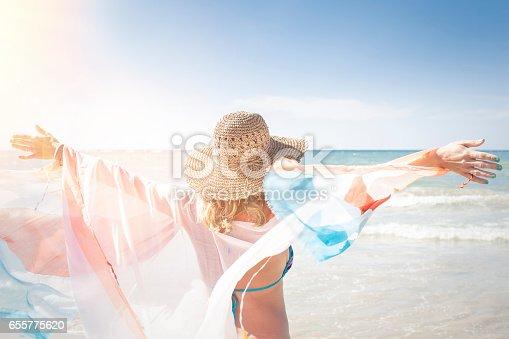 istock Beautiful woman enjoys the beach, thailand, phuket 655775620