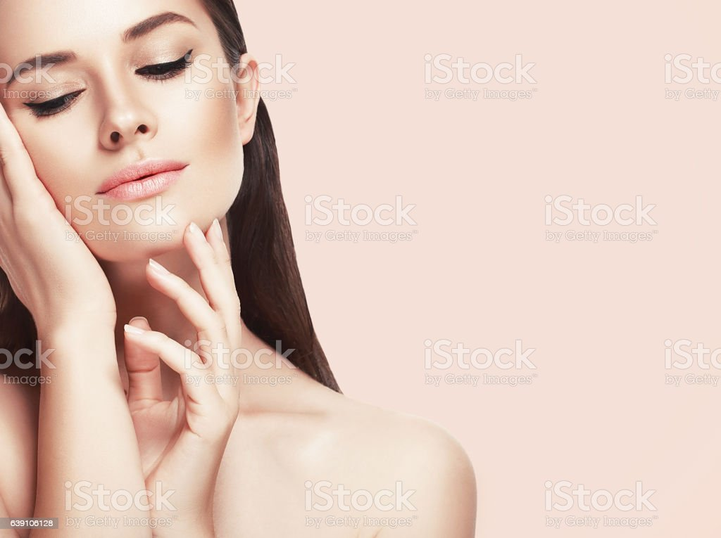 Beautiful woman face close up studio on pink stock photo