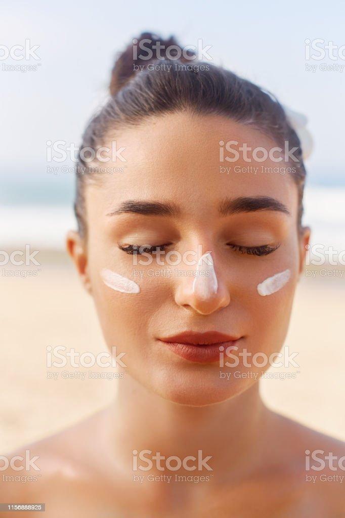 Beautiful Woman Face Portrait Beauty Skin Care Concept Suncream Suntan Lotion Beautiful Woman Applying On Beautiful On Face Sunscreen Solar Cream Sun Protectionthe Girl Uses Moisturizer Sunblock Stock Photo Download Image