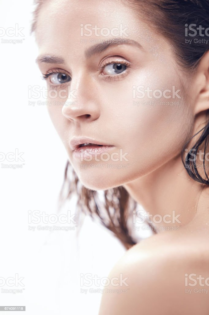 Beautiful woman face portrait close up on blue royalty-free stock photo