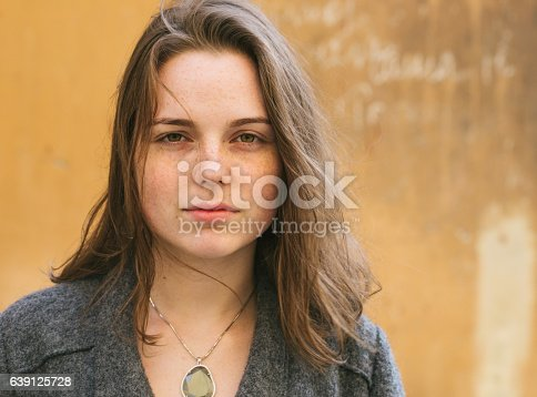 639939836 istock photo Beautiful woman face portrait freckles street city fashion 639125728
