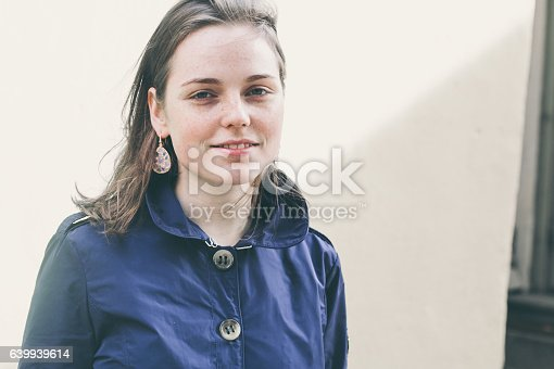 639939836 istock photo Beautiful woman face portrait freckles street city fashion 639939614