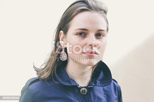 639939836 istock photo Beautiful woman face portrait freckles street city fashion 639939640