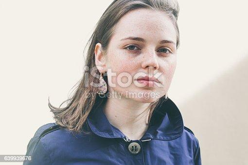 639939836 istock photo Beautiful woman face portrait freckles street city fashion 639939676