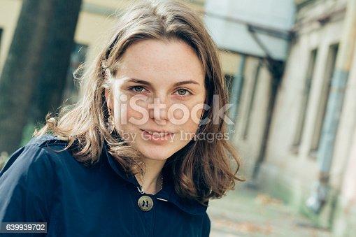 639939836 istock photo Beautiful woman face portrait freckles street city fashion 639939702