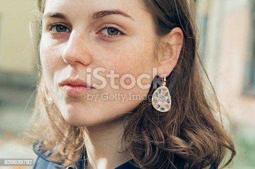 639939836 istock photo Beautiful woman face portrait freckles street city fashion 639939792