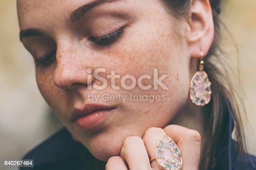 639939836 istock photo Beautiful woman face portrait freckles street city fashion 640267464