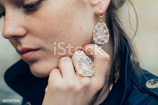 639939836 istock photo Beautiful woman face portrait freckles street city fashion 640267544