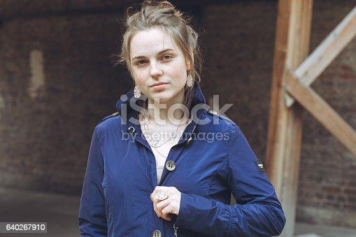 639939836 istock photo Beautiful woman face portrait freckles street city fashion 640267910