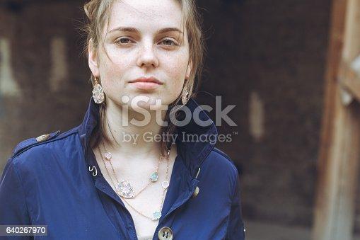 639939836 istock photo Beautiful woman face portrait freckles street city fashion 640267970