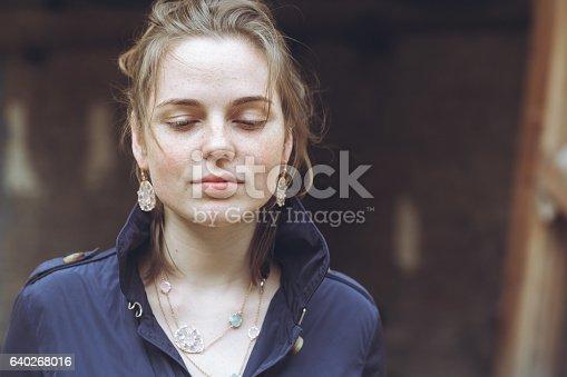 639939836 istock photo Beautiful woman face portrait freckles street city fashion 640268016