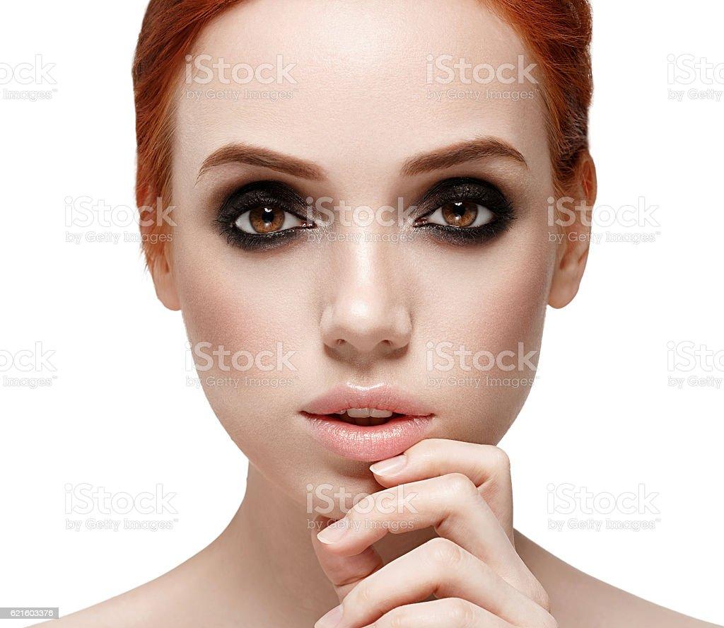 Beautiful woman face portrait. Smoky black make up on eyes. stock photo