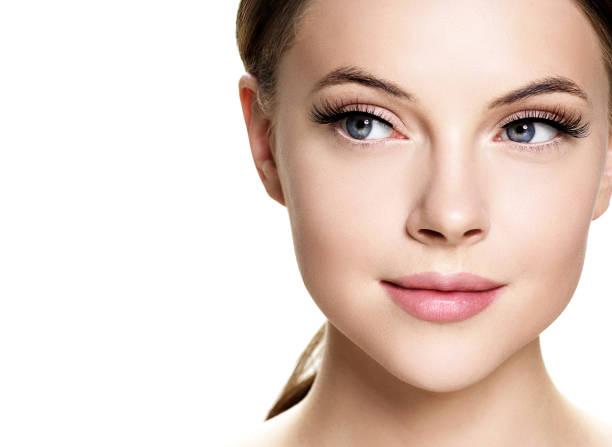 Beautiful woman face with eyelashes beauty healthy skin natural makeup. stock photo
